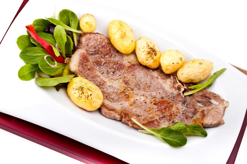 Grilled Steak And New Potatoes royalty free stock photos