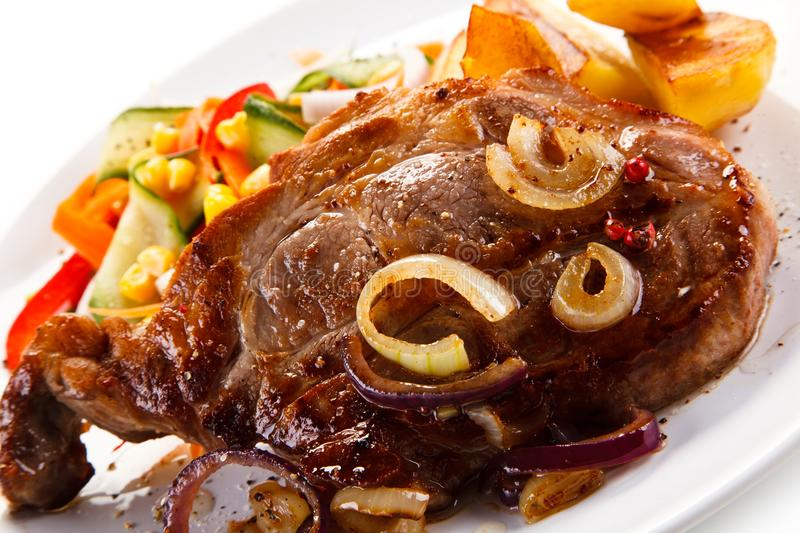 Grilled steak with potatoes. On white background stock photos