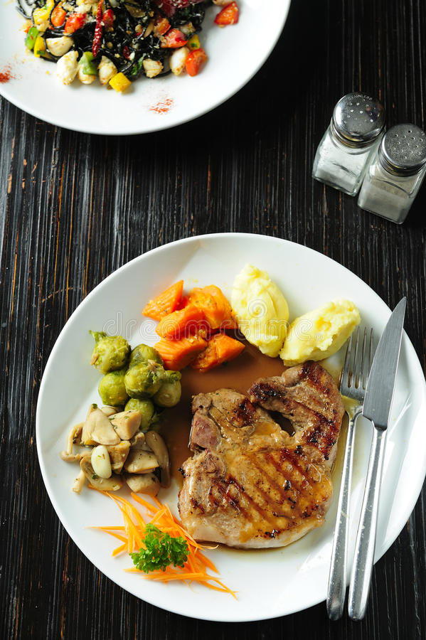 Grilled steak and vegetables royalty free stock images