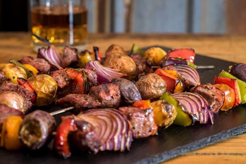 Grilled Steak and veggie kabobs for dinner. 2 grilled steak and veggie strand skewers stock images
