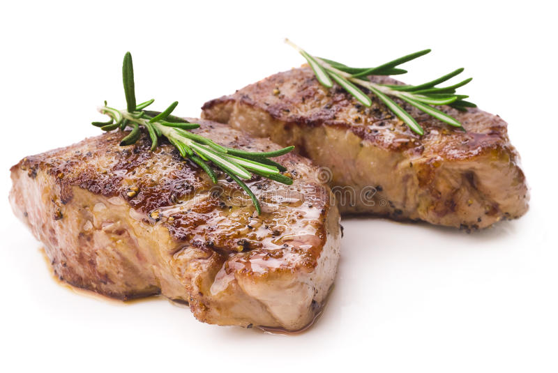 Grilled steak on white background royalty free stock images