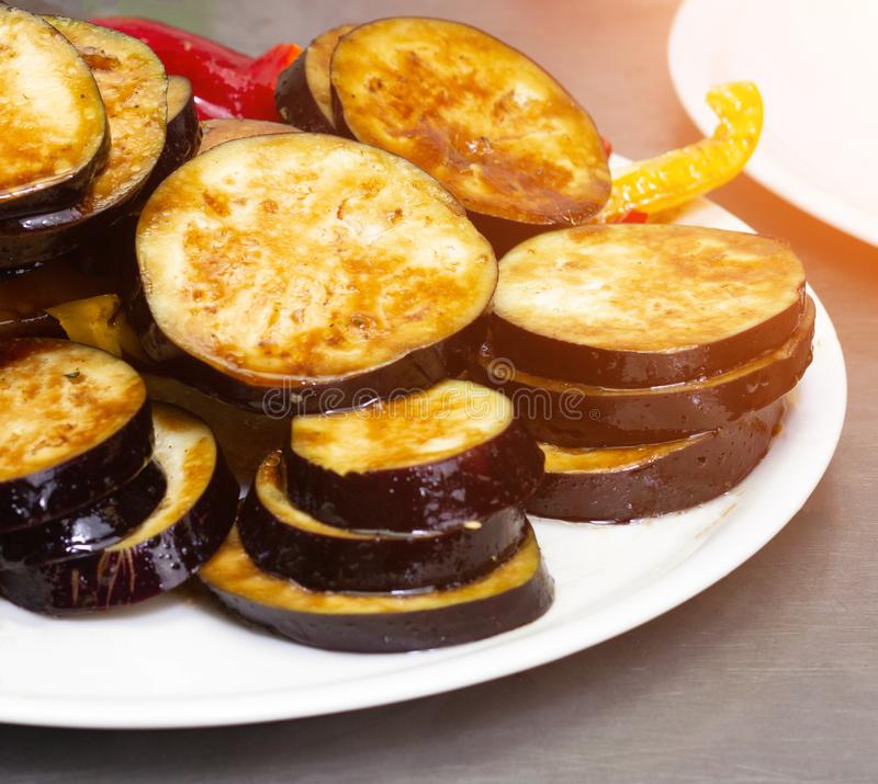 Grilled steamed and roasted vegetables eggplant and red pepper on a plate, close-up royalty free stock image