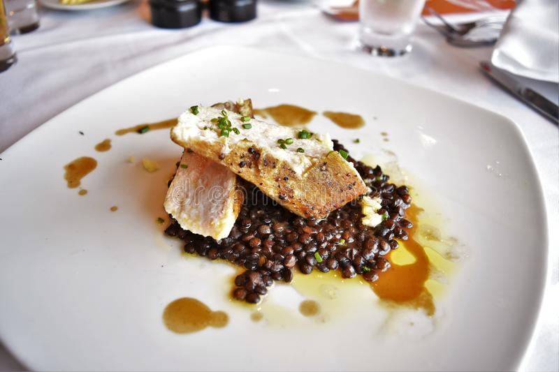 Grilled Swordfish. Loin with braised lentils and ginger garlic butter stock photo