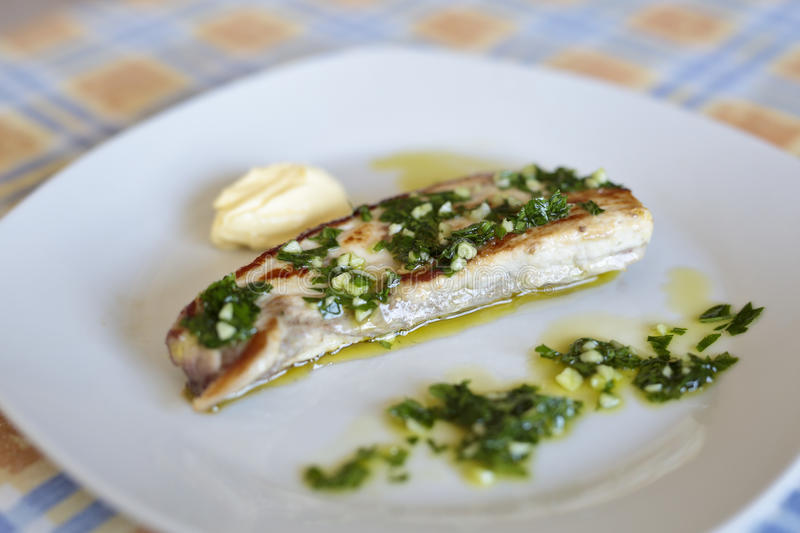 Grilled swordfish with salsa. Grilled swordfish with garlic sauce and perjil stock photography