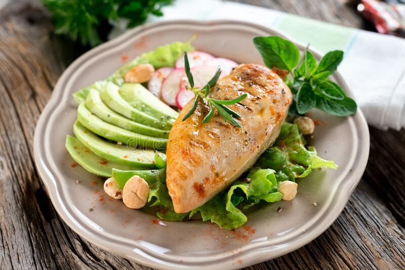Grilled tasty chicken breast with avocado royalty free stock images
