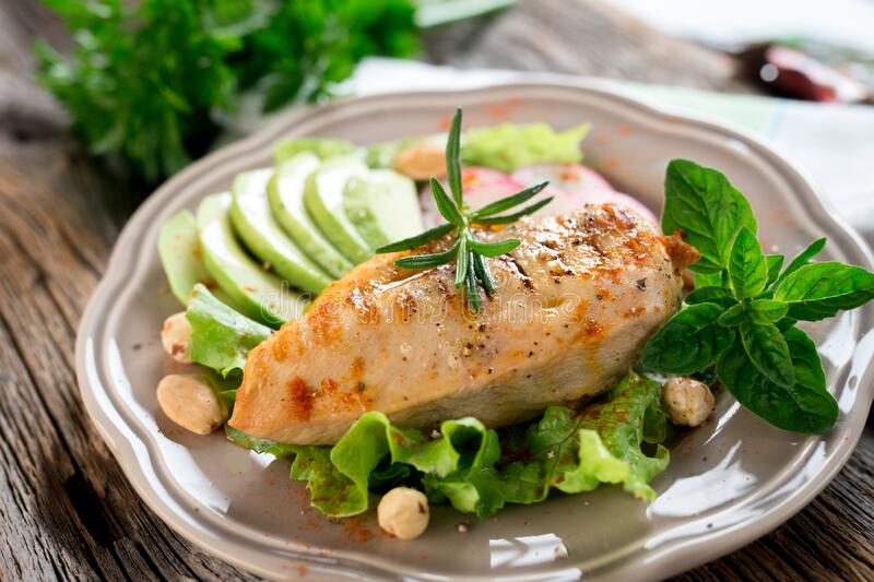 Grilled tasty chicken breast with avocado stock photos