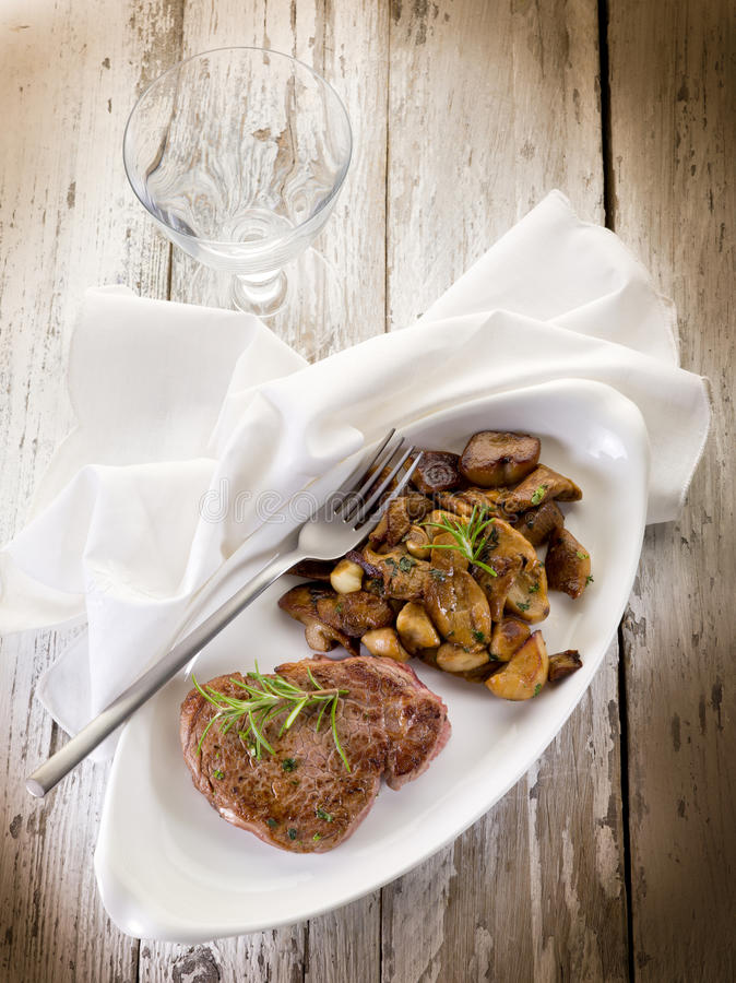 Grilled tenderloin with cep stock photo