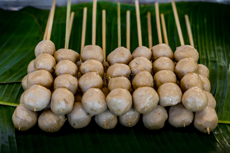 Grilled Thai`s meatball. On green banana leaves tray stock photography