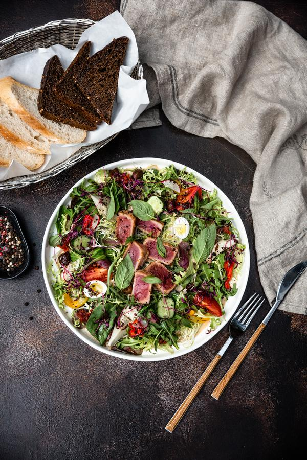 Grilled tuna with salad and vegetables for cafe menu. Close up. View from the top stock image