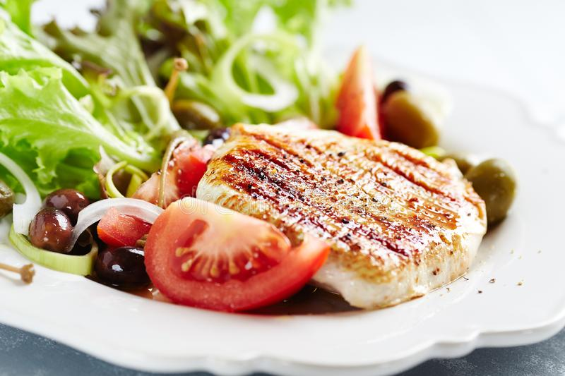 Grilled turkey breast fillet with fresh salad stock photo