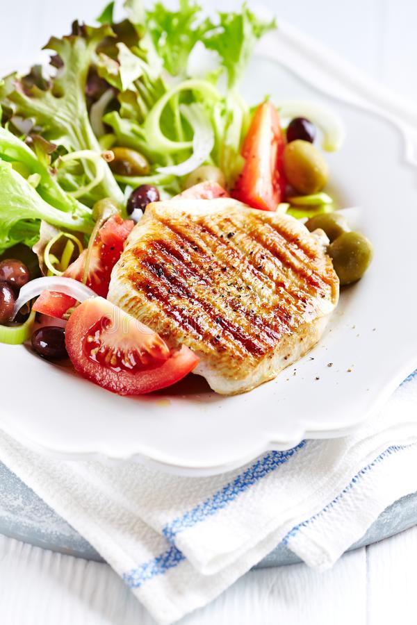 Grilled turkey breast fillet with fresh salad stock image