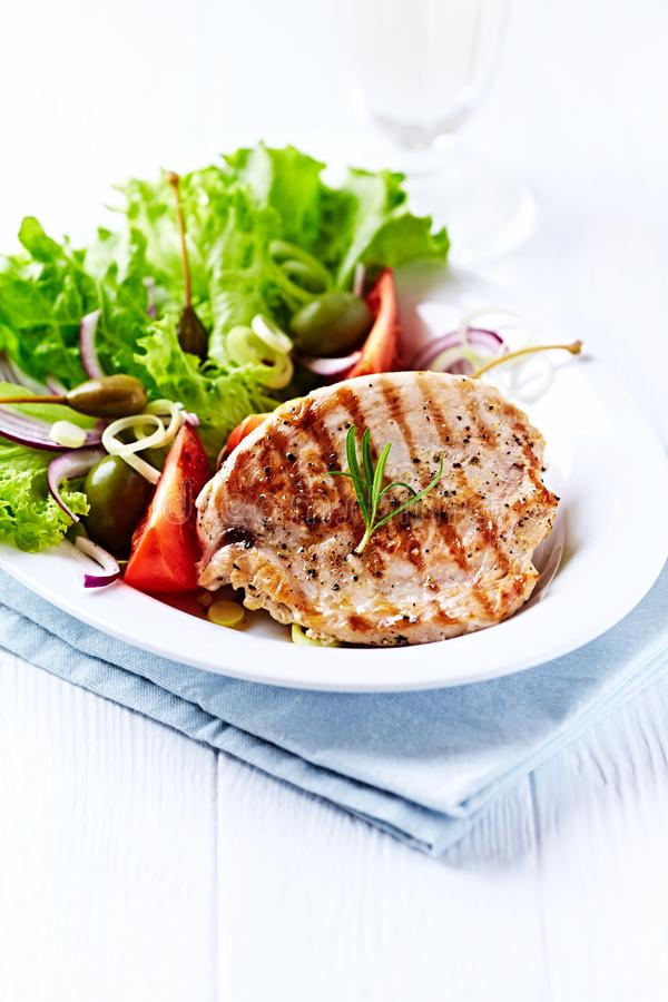 Grilled turkey breast fillet with fresh salad royalty free stock images