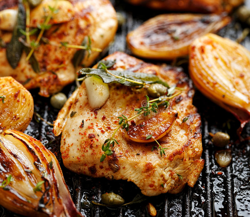 Grilled turkey fillet with addition of herbs, spices and vegetables stock image