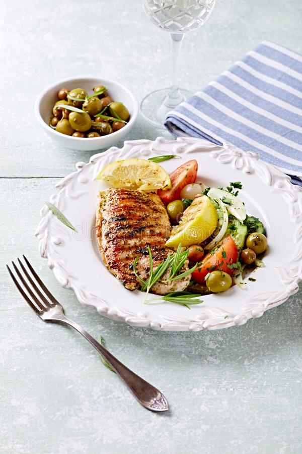 Grilled turkey fillet with grilled lemon and salad royalty free stock photos