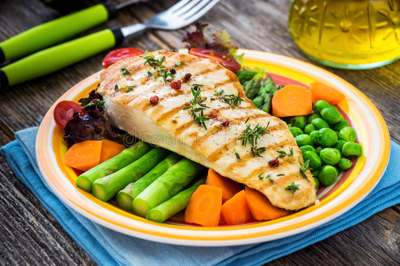 Grilled turkey fillet with vegetables stock photography