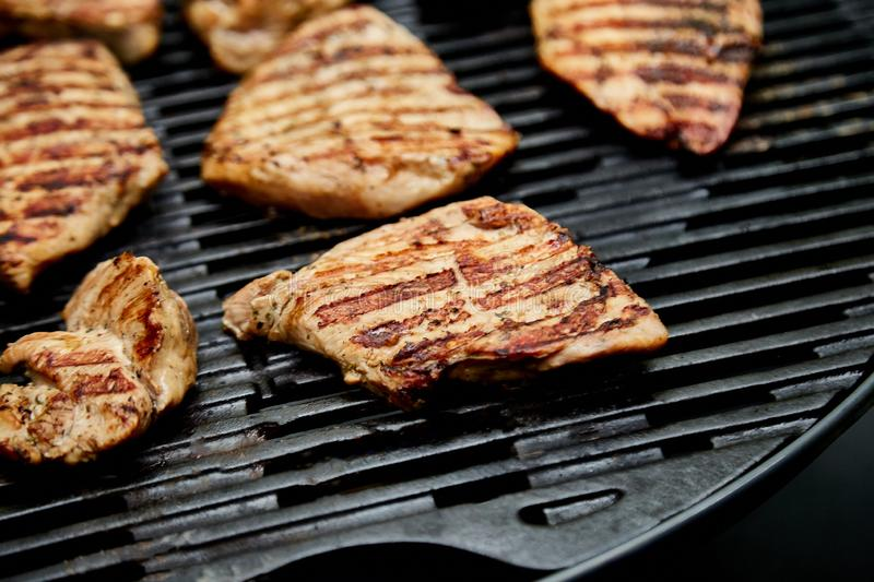 Grilled turkey meat. Steak turkey grill on on huge gas grill stock images