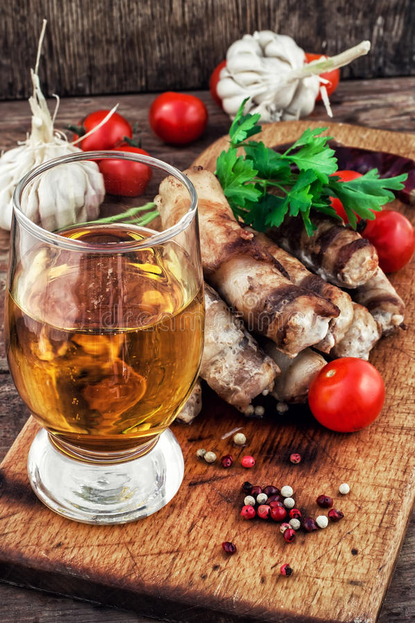 Grilled Turkey sausages with beer royalty free stock image