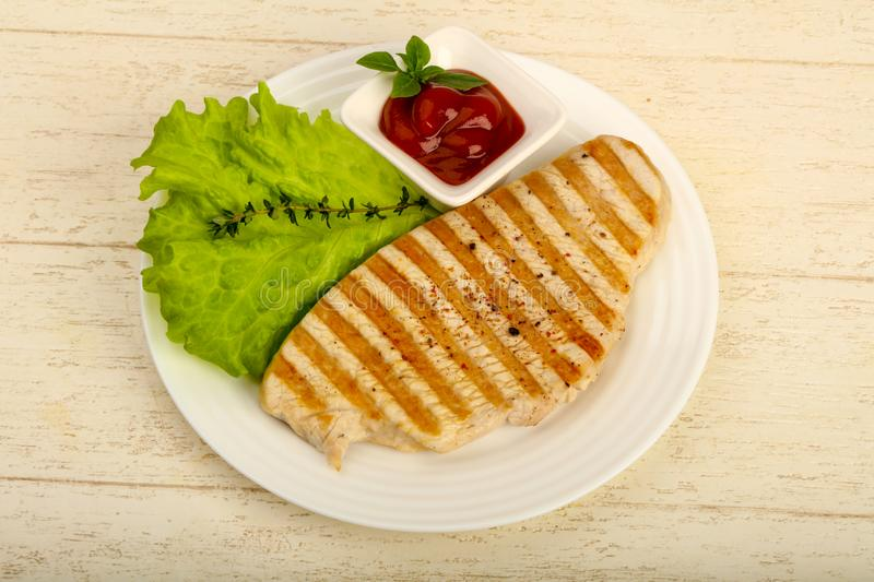 Grilled turkey steak. With spices and sauce royalty free stock image