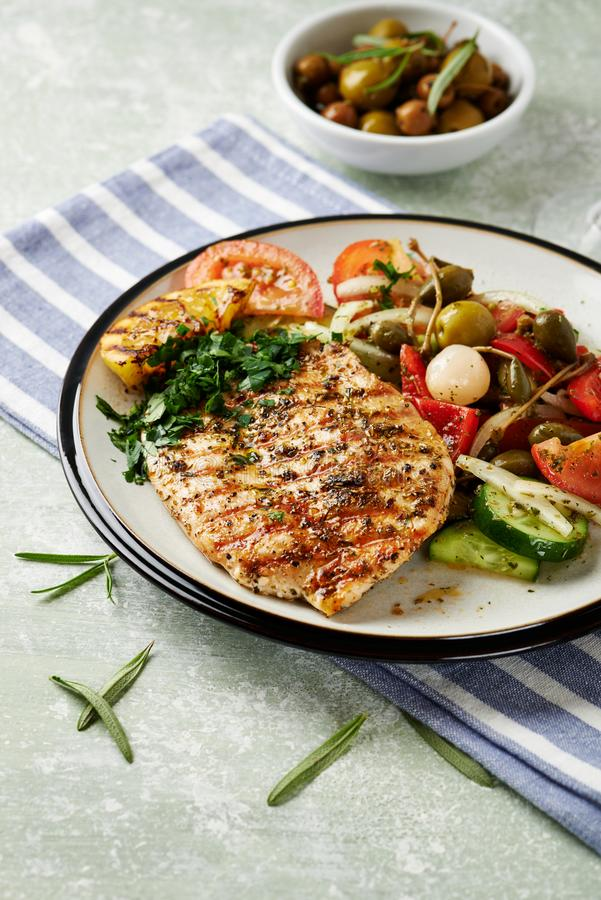 Grilled turkey steak with salad. stock photos