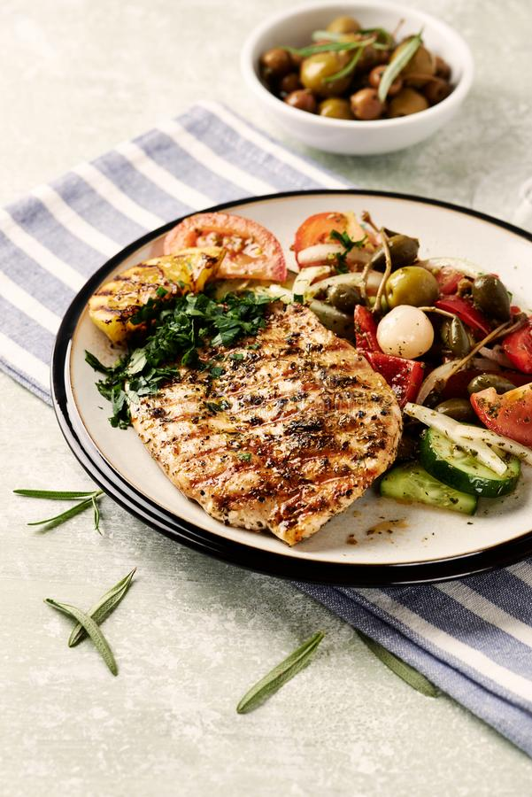 Grilled turkey steak with salad. stock photo