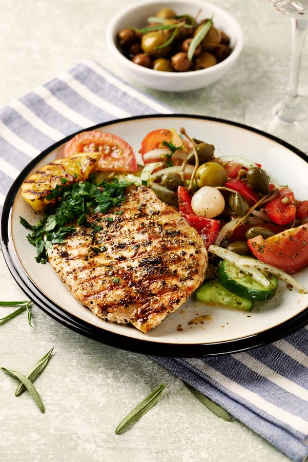 Grilled turkey steak with salad. stock image