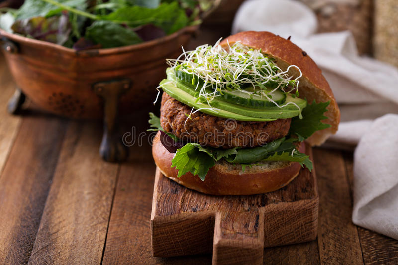 Grilled vegan bean burger with greens royalty free stock image