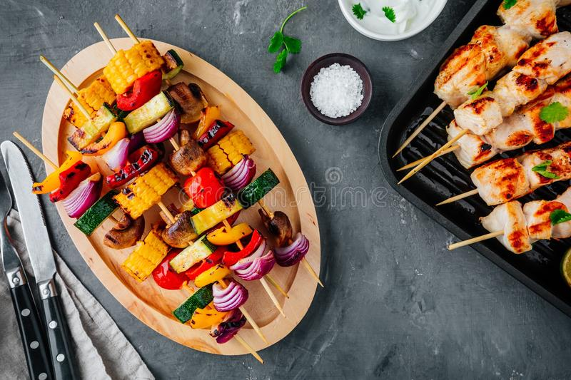 Grilled vegetable and chicken skewers with sweet corn, paprika, zucchini, onion, tomato and mushroom royalty free stock photo