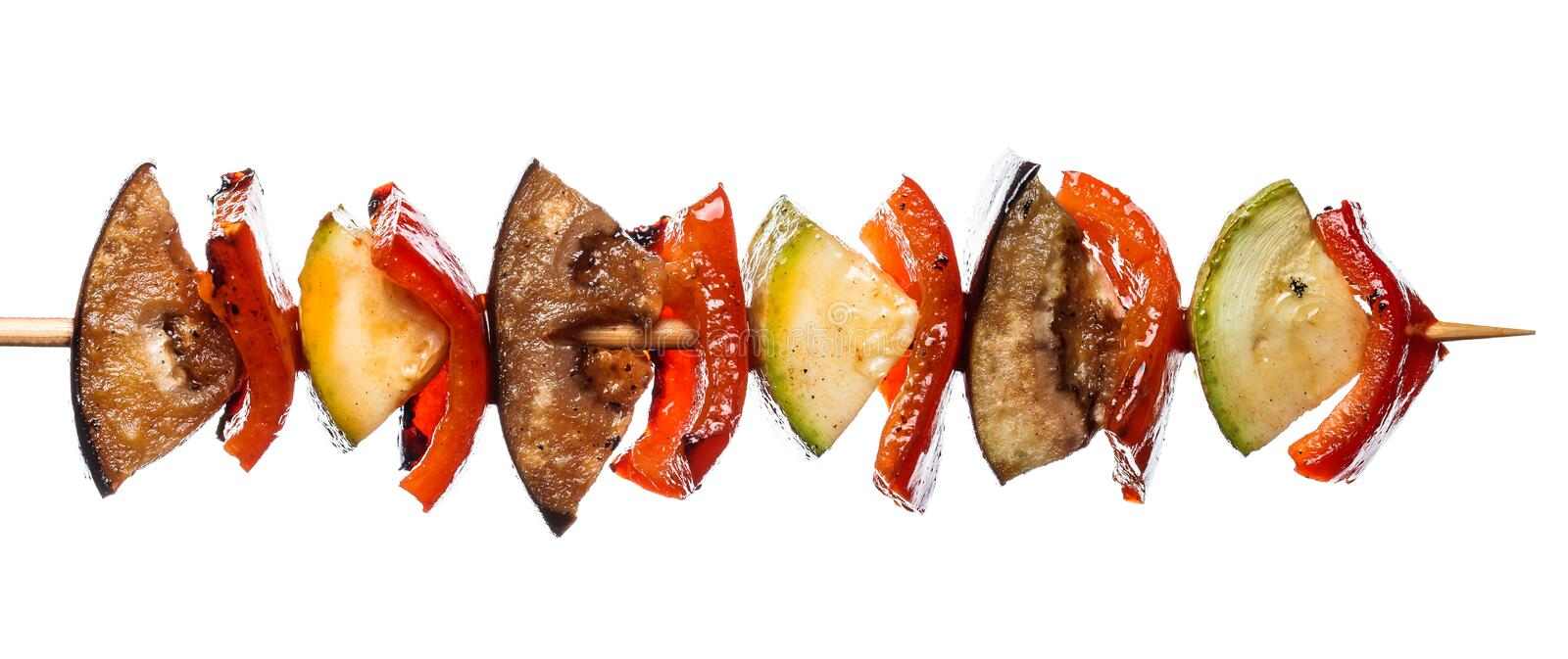 Grilled vegetable kebab on skewer with tomato, pepper, zucchini, squash and eggplant on white background, isolated food.  royalty free stock photos