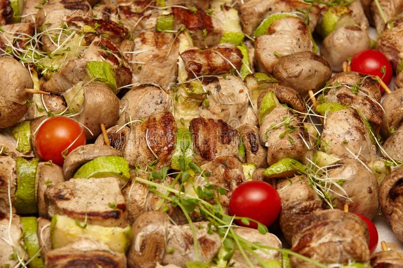Grilled vegetables and meat with greens and tomatoes stock image