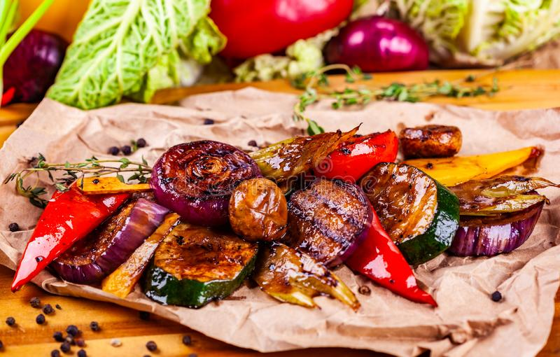 Grilled vegetables: pepper, tomatoes, onion, potatoes, mushrooms, zucchini on wooden board. Grilled vegetables: pepper, tomatoes, onion, potatoes, mushrooms royalty free stock image