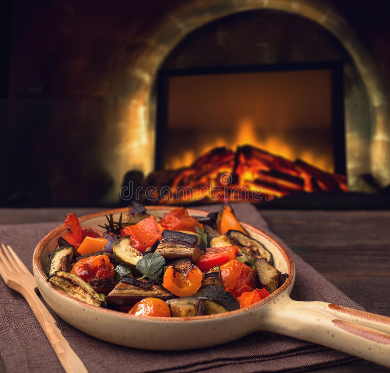 Grilled vegetables on serving pan. And fireplace stock photos