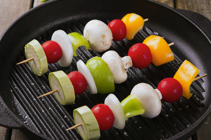 Grilled vegetables on skewers grill frying pan stock images