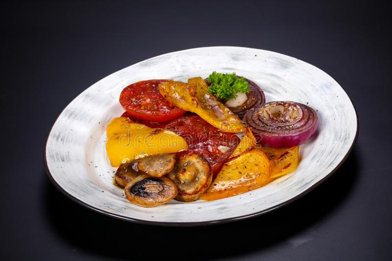 Grilled vegetables - tomato, pepper, mushroom and onion stock photography