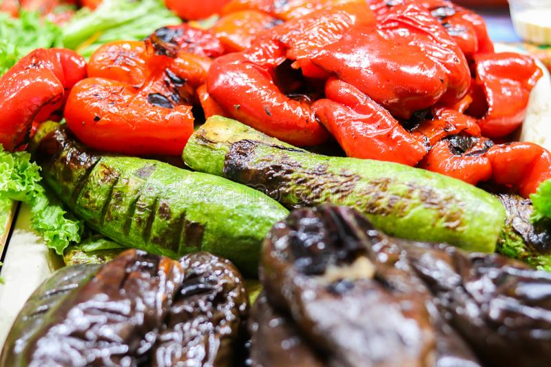 Grilled veggies bbq pepper, zucchini and eggplant. Vegetarian food background royalty free stock photo