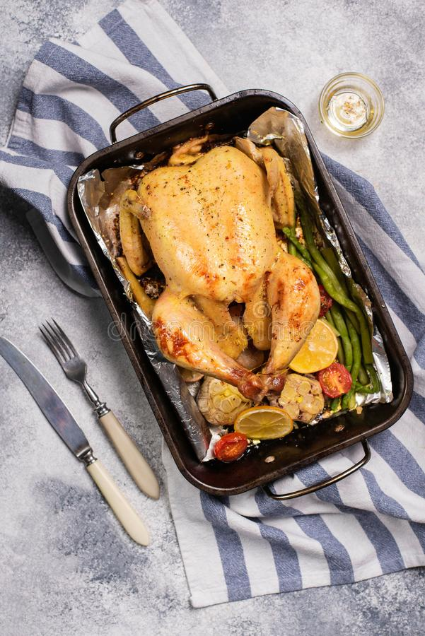 Grilled whole chicken with vegetable in dripping pan royalty free stock photos