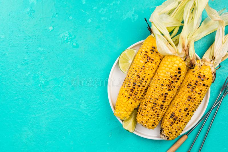 Grilled Whole Corn on Cob with Husk, Top View, Copy Space stock photos