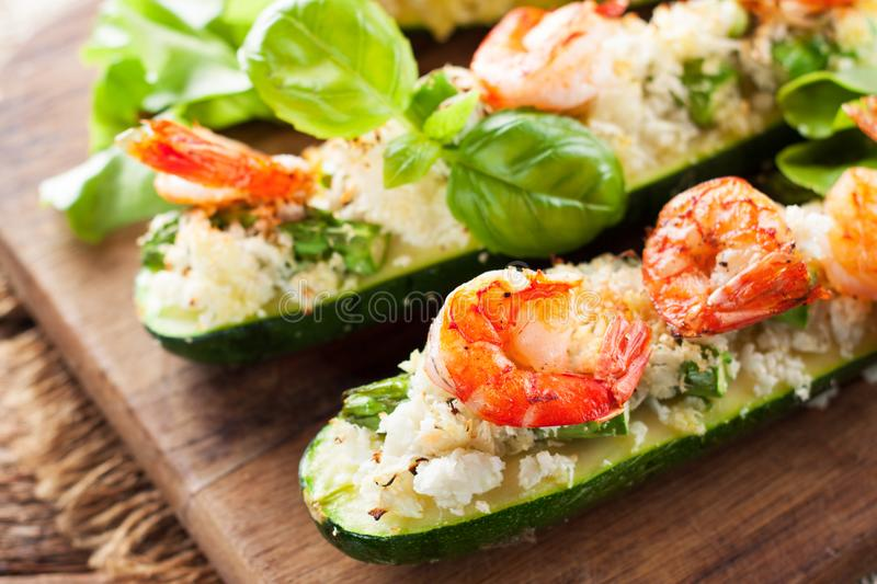 Grilled zucchini stuffed with shrimps and cauliflower rice royalty free stock photography