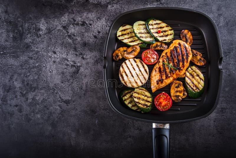 Grilled Zucchini Tomato with chili pepper. Italian mediterranean or greek cuisine. Vegan vegetarian food.  stock photos