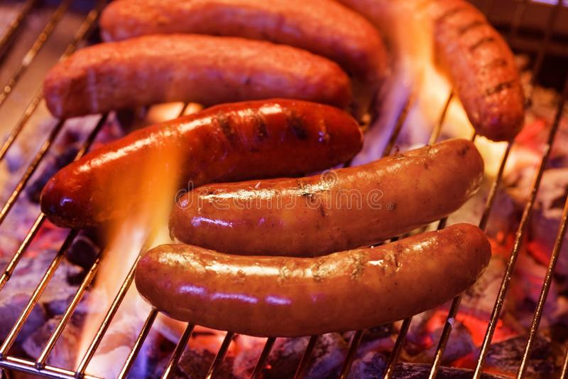 Grilling bratwursts stock photos