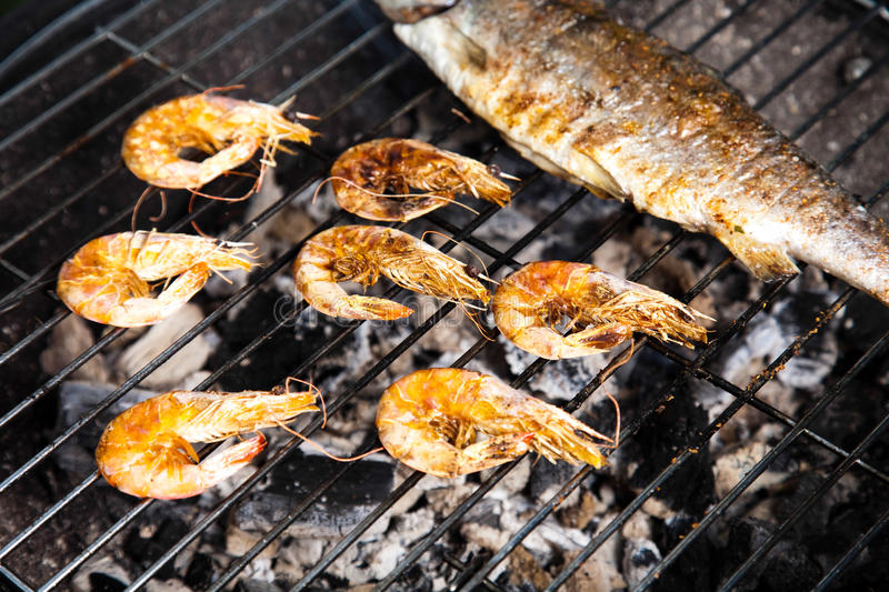 Grilling fish, bright colorful vivid theme.  stock photos