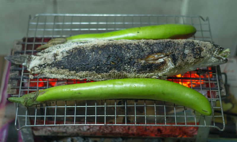 Grilling fish with eggplant on the grill. Food and beverages stock images