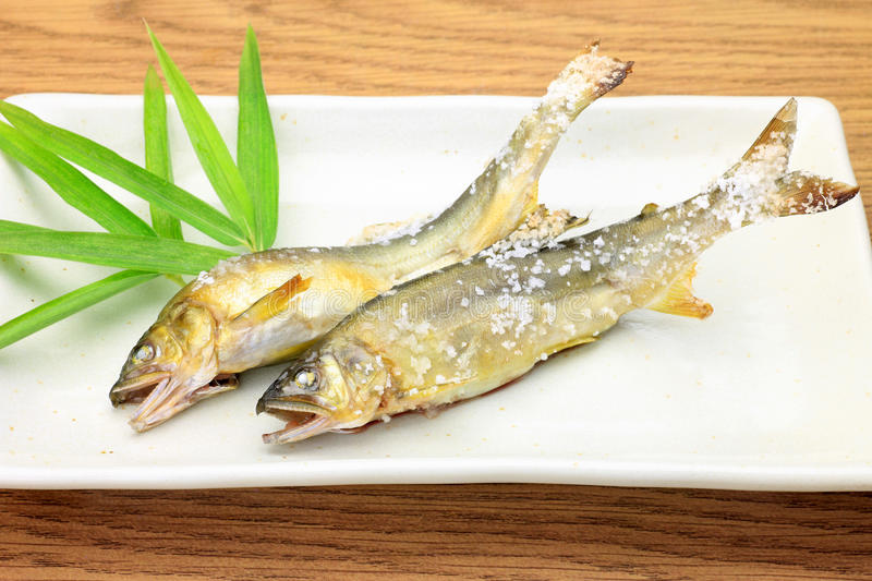 Grilling fish with salt of the sweetfish. This is a grilling fish with salt of the sweetfishs with a Japanese dish royalty free stock photography