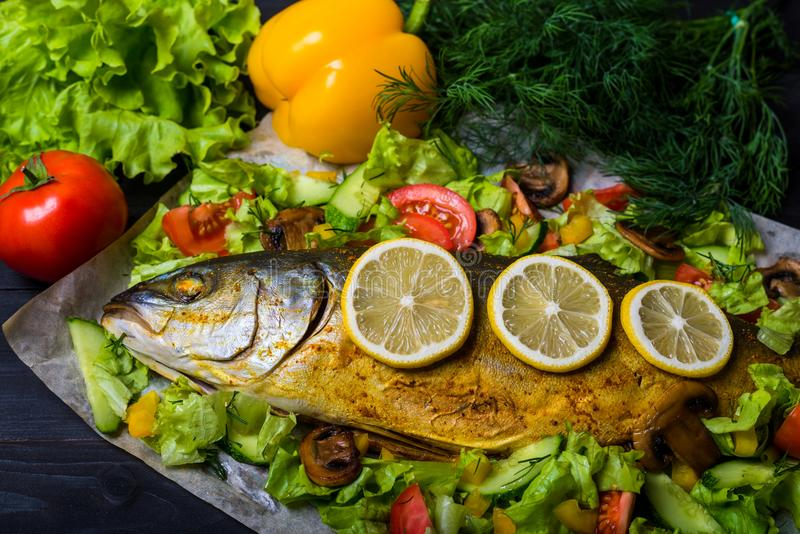 Background for your menu: fried fish with vegetables. stock photography