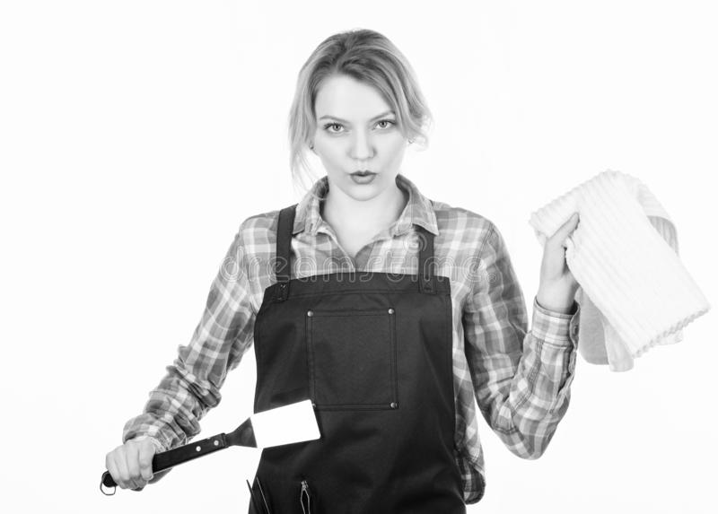 Grilling food. Woman checkered shirt and apron for cooking white background. Cooking meat at low temperature for long royalty free stock photography