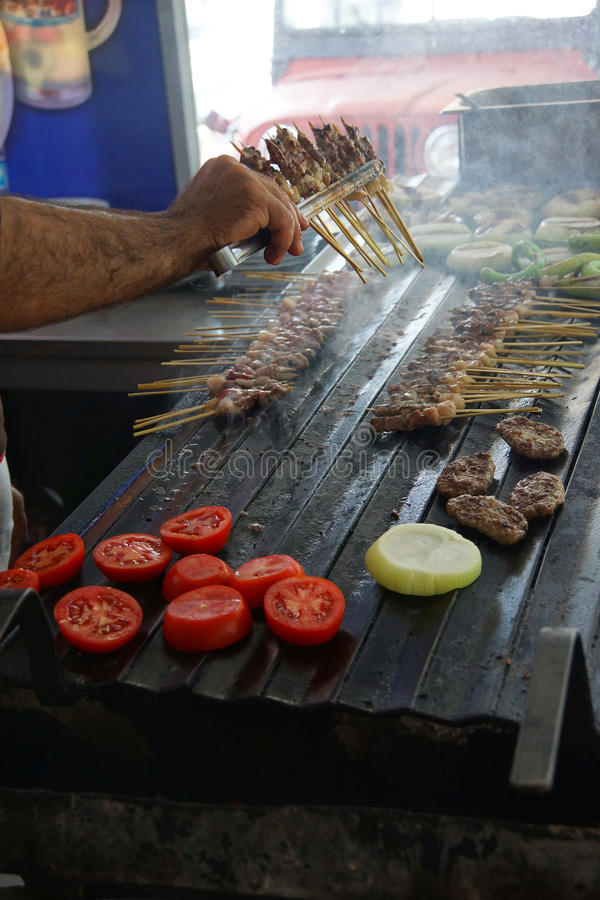 Grilling kabob skewers, onions and peppers. For lunch in restaurant near Aphrodisias, Turkey royalty free stock photography