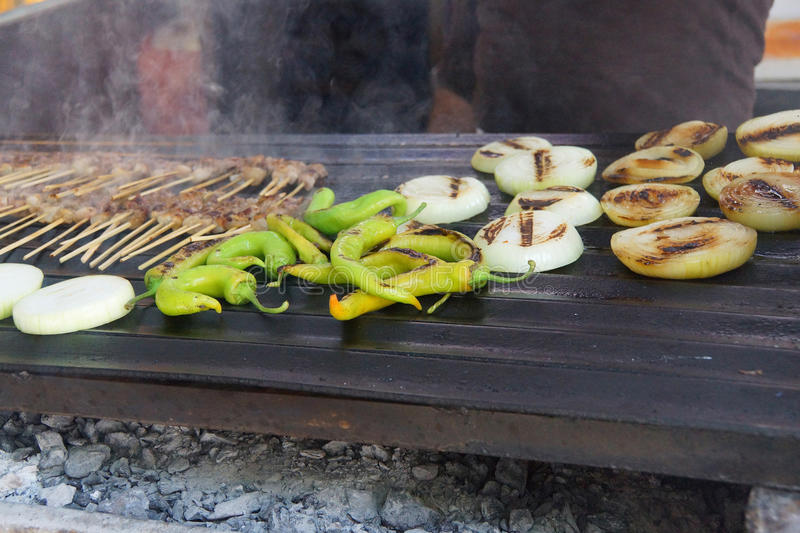 Grilling kabob skewers, onions and peppers. For lunch in restaurant near Aphrodisias, Turkey stock photo