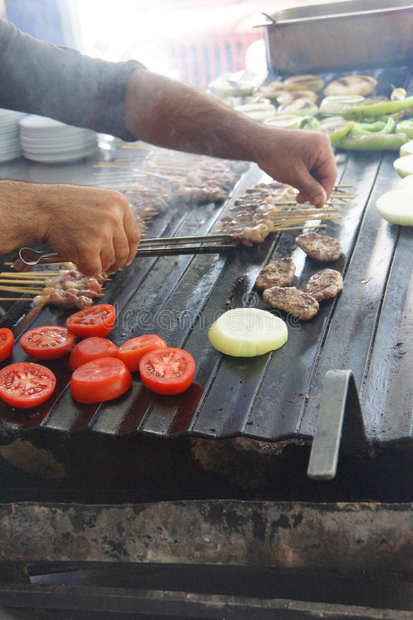 Grilling kabob skewers, onions and peppers. For lunch in restaurant near Aphrodisias, Turkey stock photography