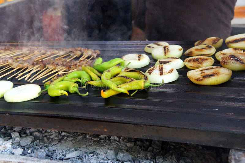 Grilling kabob skewers, onions and peppers. For lunch in restaurant near Aphrodisias, Turkey stock images