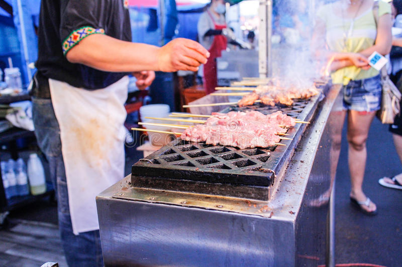 Grilling lamb skewers at night market. Grilling some lamb skewers at night market stock photography