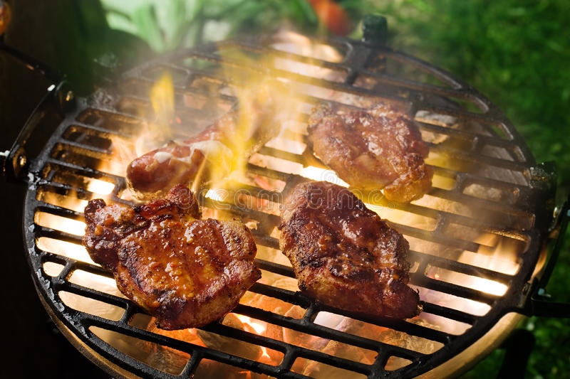 Grilling marinated meat royalty free stock images